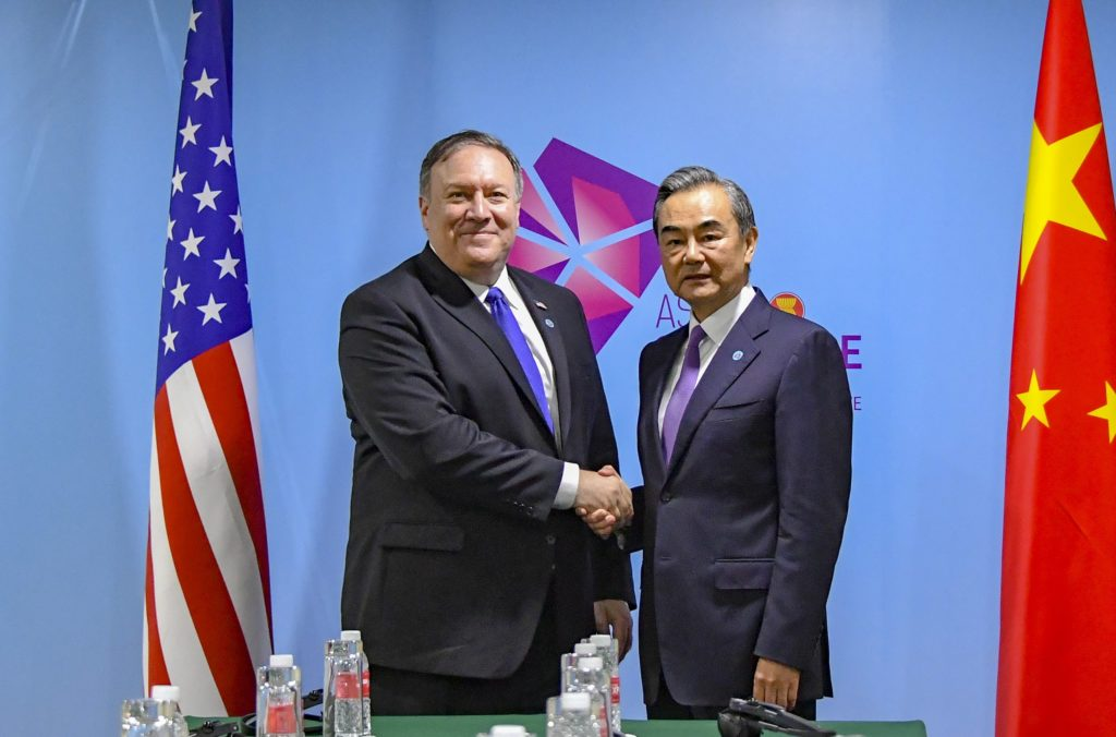 Secretary Michael R. Pompeo shakes hands with Chinese Foreign Minister Wang Yi